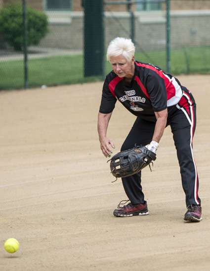 Photo of Jan fielding a ball at 3rd base w/ Link to Jan's story